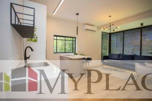 In the Basel area, a three-bedroom apartment renovated and designed