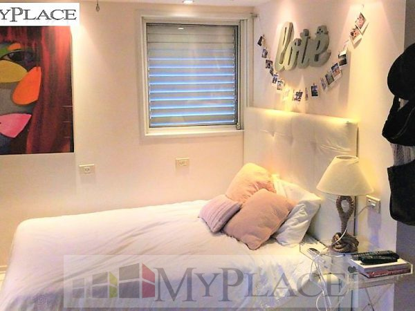 A huge apartment with an elevator terrace and a parking lot in the posh Bavli 4