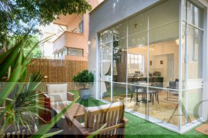 A renovated architectural apartment with a garden on Ben Yehuda street